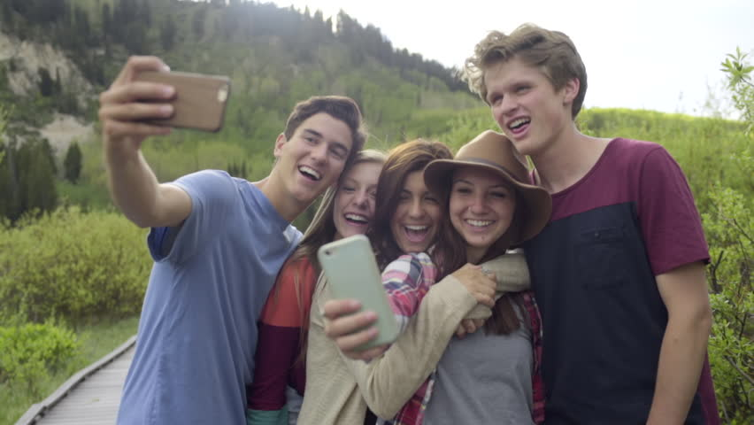 Group Of Fun Teens On An Adventure Take Silly Selfies, Smile And Make Faces (Slow Motion)