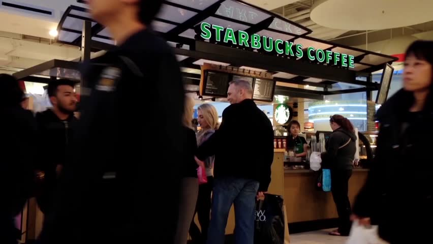 Burnaby, BC, Canada - April 06, 2015 : Customer line up for buying coffee at Starbucks