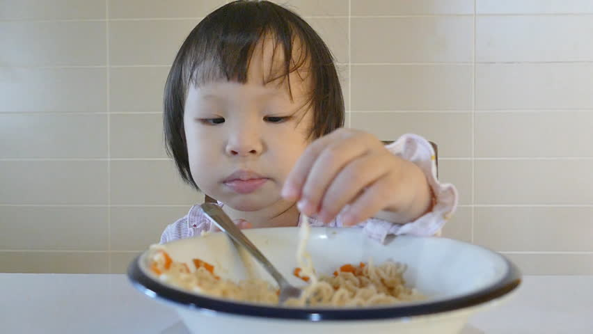 Asian girl eats herself
