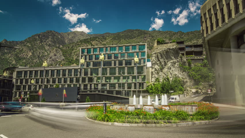 Motion timelapse (hyperlapse, time lapse, time-lapse) of city traffic at the square near city hall of Andorra La Vella, Andorra.