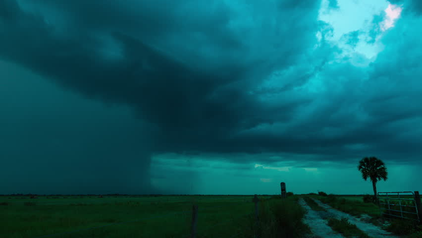 Time-lapse of severe pulse thunderstorm with intense lightning over the southern Florida wetlands at dusk.