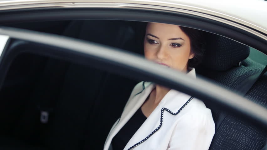 Business Woman In The Window Of His Official Car Beautiful Young