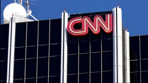 HOLLYWOOD, CA/USA - MAY 2, 2015: CNN building exterior and logo. Cable News Network (CNN) is an American basic cable and satellite television channel that is owned by Time Warner.