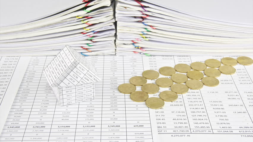 House and gold coins as river on finance account with stack old paper report of sales and receipt as background time lapse. Gold coins are increasing as work successful. Business concept footage. | Shutterstock HD Video #10845824