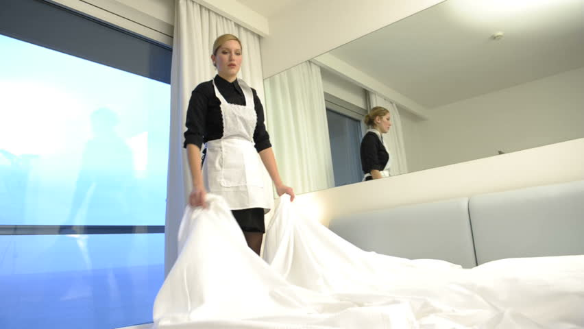 Maid making bed; HD Photo JPEG