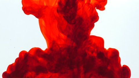 Red ink in water, slow motion, abstract.