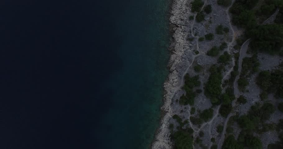 Texture of coast, shore, water and vegetation. Drone moves to the side slowly. Dalmatian coast, Croatia. Bay.   Shutterstock HD Video #10868294