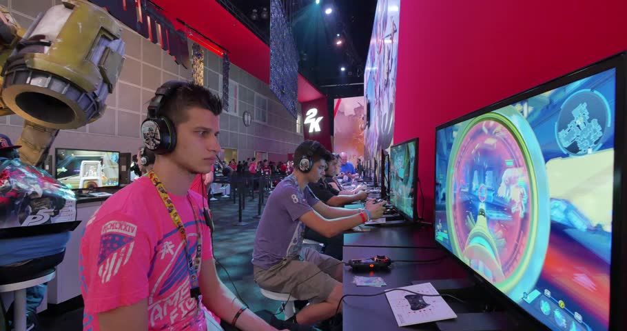 LOS ANGELES - June 16, 2015: Gamers playing Battleborn video game  developed by Gearbox Software, to be published by 2K Games for PlayStation 4, Xbox One and Microsoft Windows. E3 2015 expo. 4K UHD.