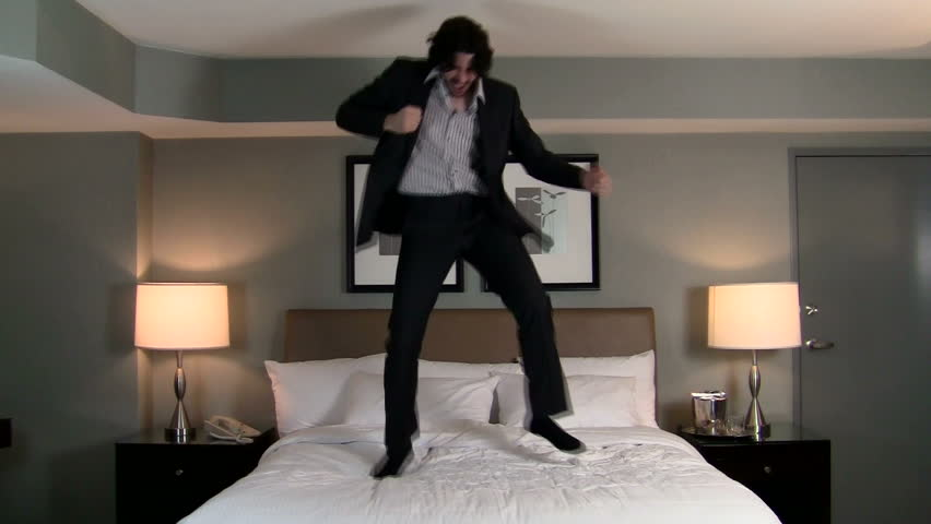 Businessman jumps on bed - HD | Shutterstock HD Video #1089115