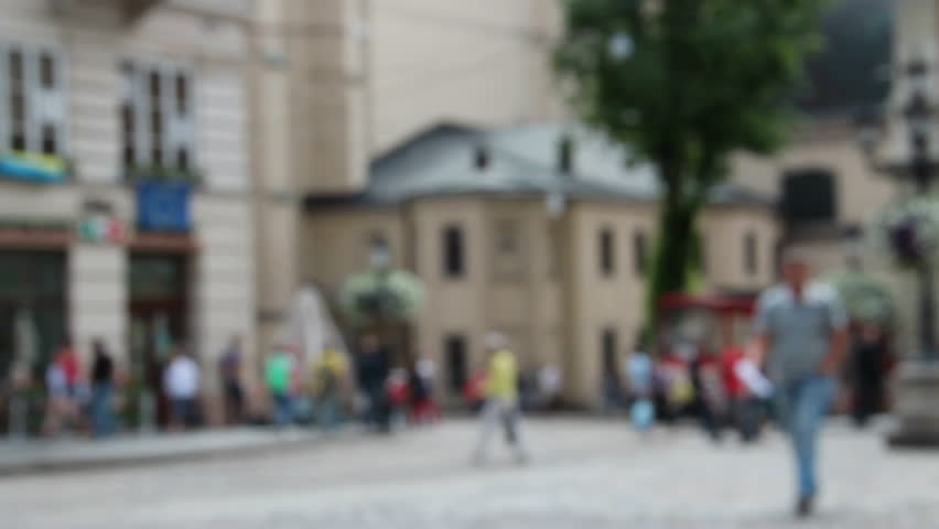 Blurred people on the Market (Rynok) square of Lviv - the central square and most popular touristic place in historical part of town