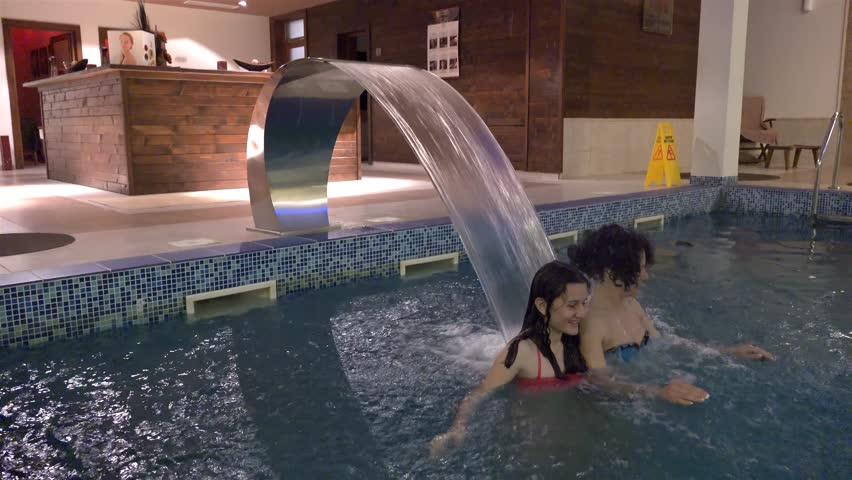 Mother And Daughter Enjoy Spa Pool Water Jet Massage. UHD 4K ...