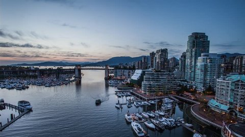 TImelapse from Granville bridge showing magical sunset over Yale town and West End in Vancouver