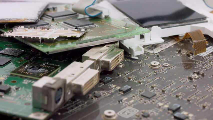 macro tracking shot over scrap circuit boards 3/12