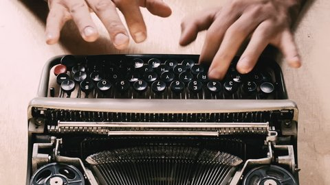 Typing a film script or a book on a vintage typewriter
