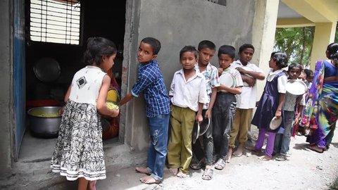 MAHARASHTRA, INDIA July 10, 2015: food serve to rural school children, July 10, 2015, Salunkwadi, Ambajogai, Beed, Maharashtra, India