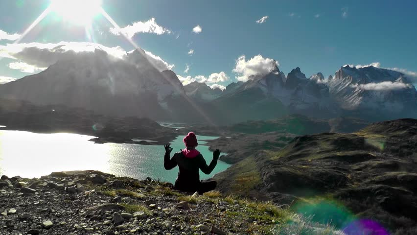 Person practising meditation in Torres del Paine National Park, Chile