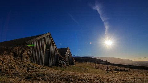 Sunlight disappearing during the partial solar eclipse on Mar 20, 2015 at Sel, the traditional turf-roofed farmhouse, Skaftafell, Vatnajokull National Park, Southern Iceland. (Time lapse)