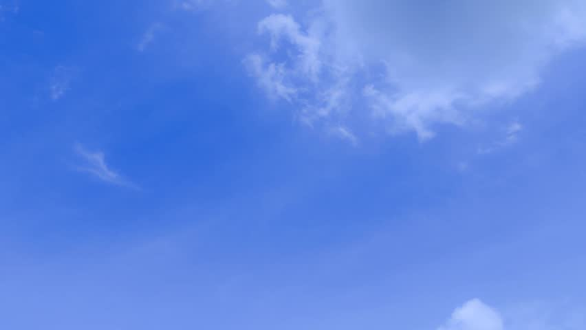 Beautiful white clouds in time lapse over a deep blue sky background. Timelapse. #11099984