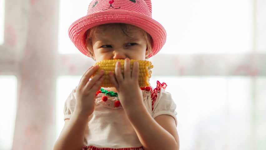 Little girl eat sweet corn | Shutterstock HD Video #11110244