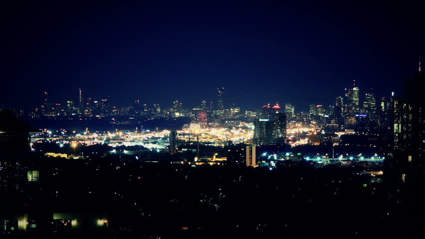 City Night Scene Wide Zoom Timelapse. City night scene from long distance, stylized establishing shot of Toronto, Canada or a generic urban location. Shot in time lapse and zooming in. | Shutterstock HD Video #11113574