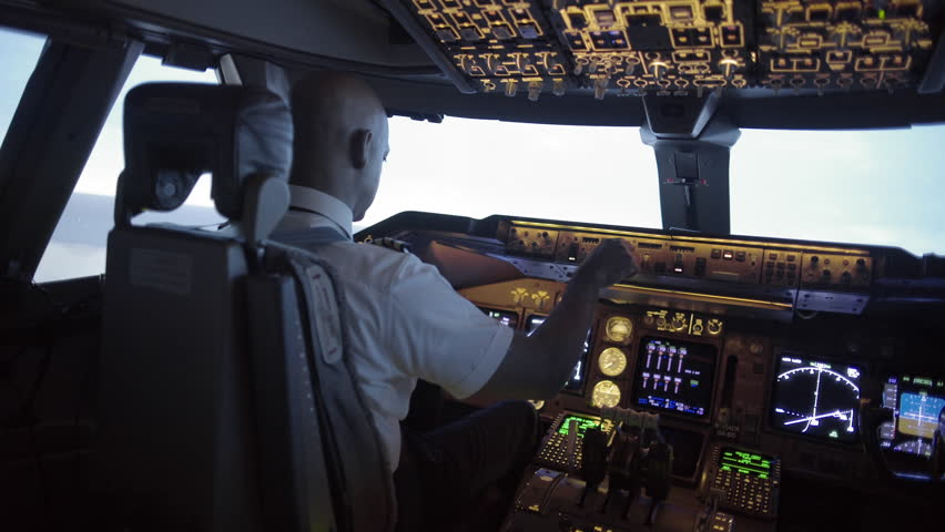 Dramatic angle from rear of 747 cockpit as African American pilot makes a long turn over an area of northern California, USA. Stabilized hand-held camera, mid shot, originally recorded in 4K at 30ps | Shutterstock HD Video #11156564