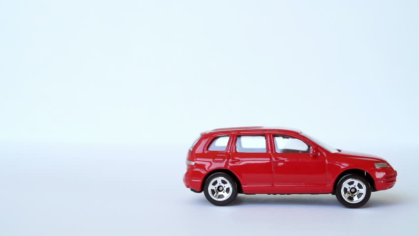 Red Toy Car Rolls Into Stock Footage Video 100 Royalty Free 11176964 Shutterstock