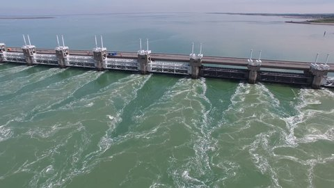Aerial Drone Video (Ultra HD) of the famous Dutch Delta Works. Seawater barriers engineered  for sea level protection. Camera: Steady POV forward approach and passing by.
