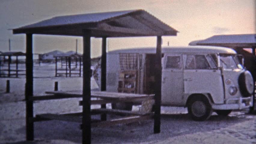 KEY WEST, FL -1971: Hippie VW van parked beach girls scenes.