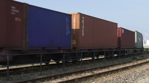 MAASVLAKTE II, ROTTERDAM - AUGUST 2015: freight train - close up container wagons passing. The railway, connecting Rotterdam with China, is called the new silk road