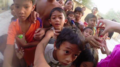 PHNOM PENH, CAMBODIA - JANUARY 2015: Charity donation to poor kids