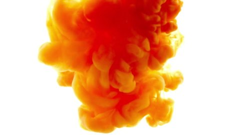 Orange ink in water.Creative slow motion. On a white background.