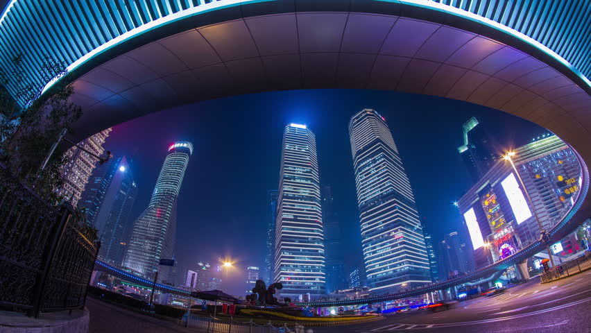 SHANGHAI - CIRCA 2013: Time Lapse of traffic and people walking pass in Pudong in Shanghai with IFC buildings in the background
