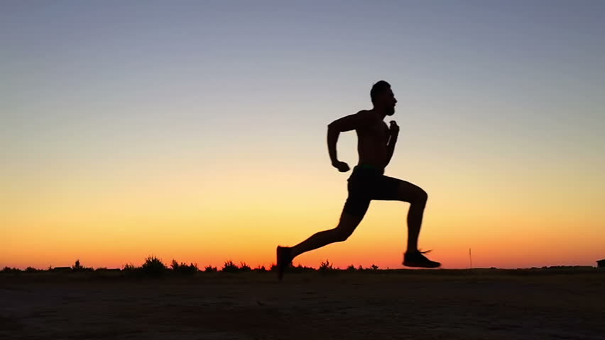 SLOW MOTION: Running man silhouette in sunset time   Shutterstock HD Video #11373104