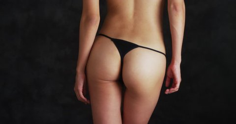Rear view of a Chinese woman in a black thong
