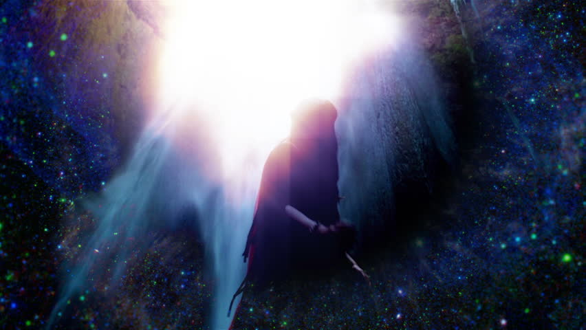 Sensual universe goddess dancing in front of waterfall