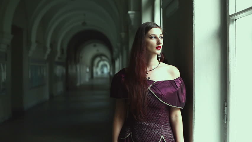 Girl standing at the window, behind a terrible man. They gothic outfits. | Shutterstock HD Video #11485304