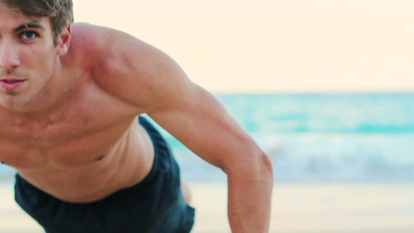 Fit Young Man Exercising On Beach Shallow Depth Of Field Close Up Full Body Push