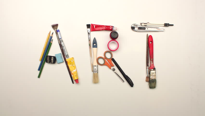 Art title made from artistic tools on white table background - stop motion animation