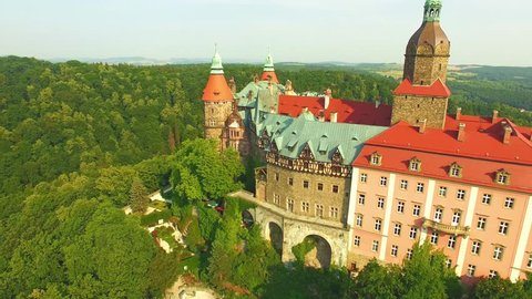AERIAL view of Medieval Castle Ksiaz in city Walbrzych, Poland, Lower Silesia. Flight over beautiful big monumental castle, located in landscape park with mountains and deep forests. Travel Europe.