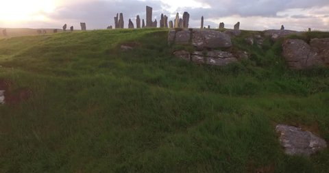 Cinematic aerial shot of Callanish standing stones on the Isle of Lewis, Outer Hebrides, Scotland