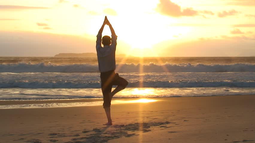 HD 1080i: Businessman man doing yoga on a beach at sunrise.