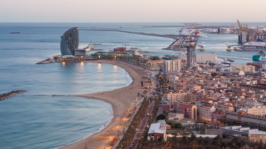 Elevated dusk view over Barcelona beaches and seaport, Barcelona, Catalunya, Spain - timelapse