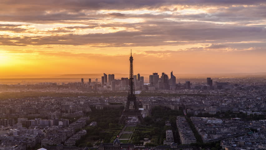 Elevated view of the Eiffel Tower, city skyline and La Defence skyscraper district in the distance, CIRCA 2015- Paris, France - timelapse | Shutterstock HD Video #11605709