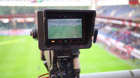 Screen of TV camera during shooting reportage at soccer stadium.