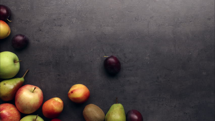 Kitchen Table Background fresh fruits moving on kitchen table background, stop motion