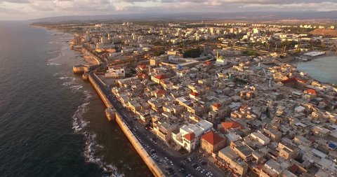 Stunning aerial view of the fortress at Acre and the Mediterranean Sea along the cost of Israel. Filmed using a DJI Inspire 1 drone.