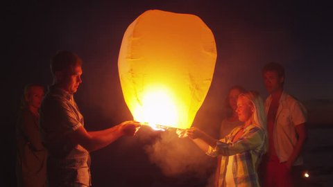 Group of Friends are Launching Sky Lantern. Shot on RED Cinema Camera in 4k (UHD)