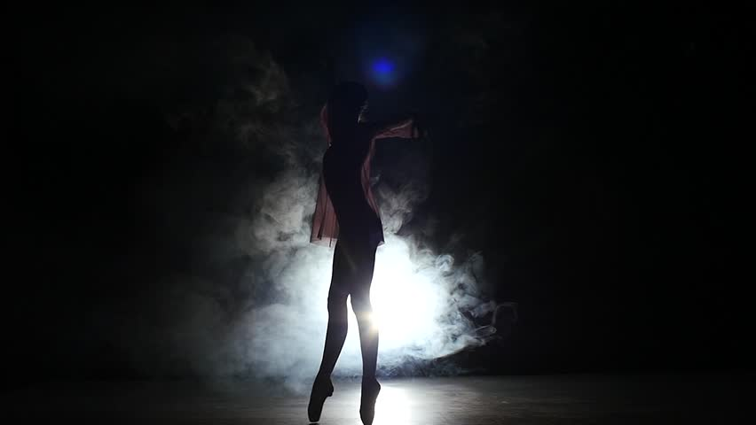 little cute girl ballerina in dress in a black suit standing in a large hall. slow motion