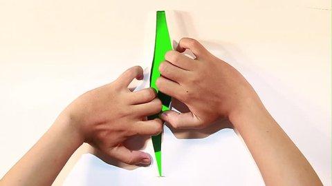attractive hand gesture opening paper into green screen