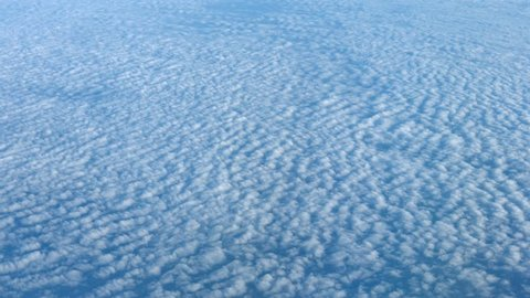 Video 4k - Airborne shot of Altocumulus Clouds over an Expanse of Open Ocean. from Above